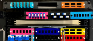 3D Printed Colored Fiber Optic Adapter Panels on a Distribution Rack